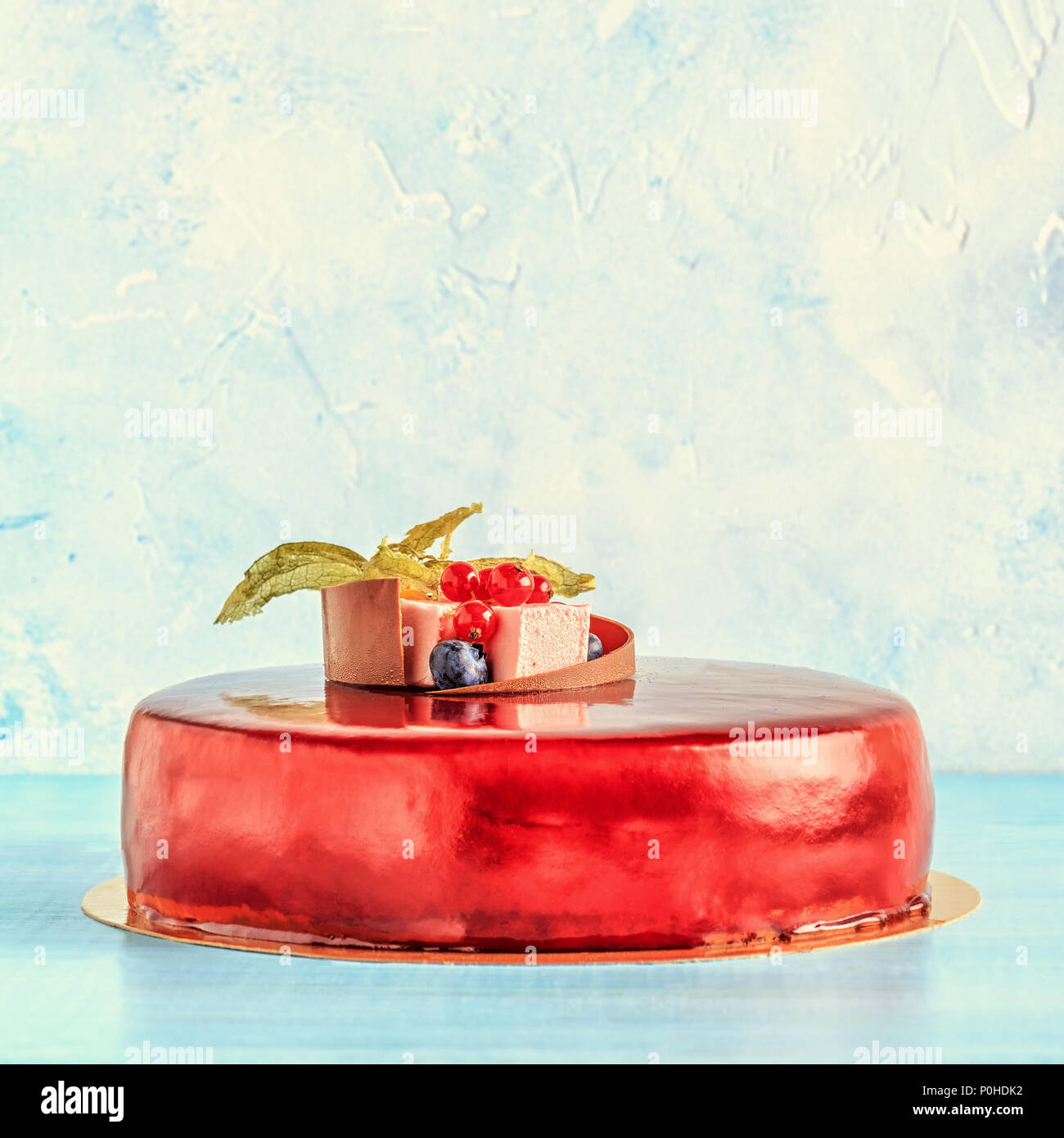 Red Cream Icing Cake with Fruits and Chocolate. Birthday cake. - Stock Image