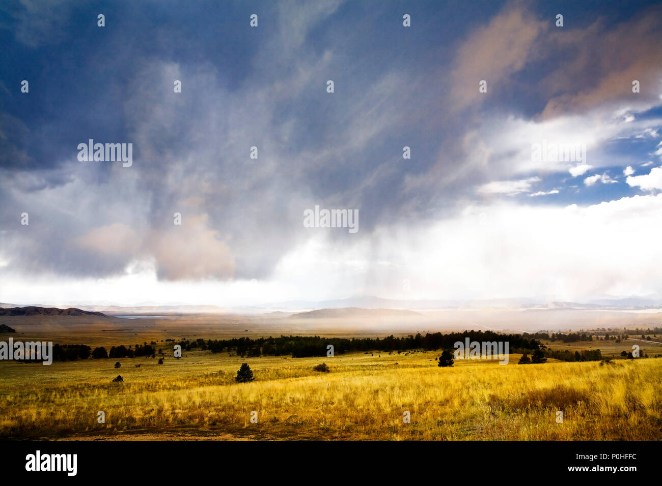A rainstorm sweeps across Spinney State Recreation area in central, Colorado. - Stock Image