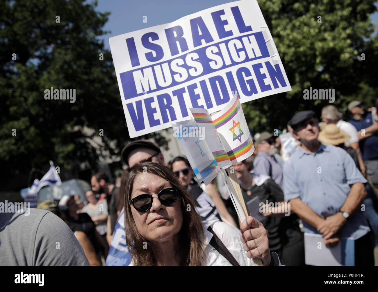 09 June 2018, Germany, Berlin: Protesters oppose ongoing anti-Israel demonstrations on Quds Day, which calls for a show of solidarity with Palestine at the end of Ramadan. Photo: Carsten Koall/dpa - Stock Image