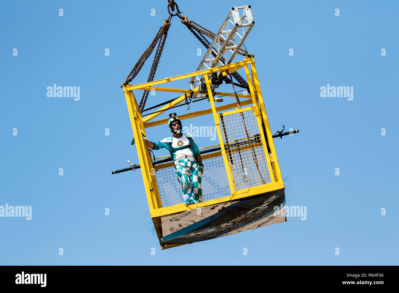 Blackpool, Lancashire, UK. 9 June 2018. The AirgameZ is the definitive BASE jumping competition of the Great British Isles. Elite jumpers from around the world are invited to participate from our 473ft high crane in competition to see who has the nerve, skill & style to thrill the crowds & win the judges scorecards. From this altitude jumpers can expect a solid delay of over 3 seconds, perform staged-deployment multi-ways, AAF style linked exits & aerobatic multi-axis rotations on descent. Credit:MediaWorldImages/AlamyLiveNews. - Stock Image