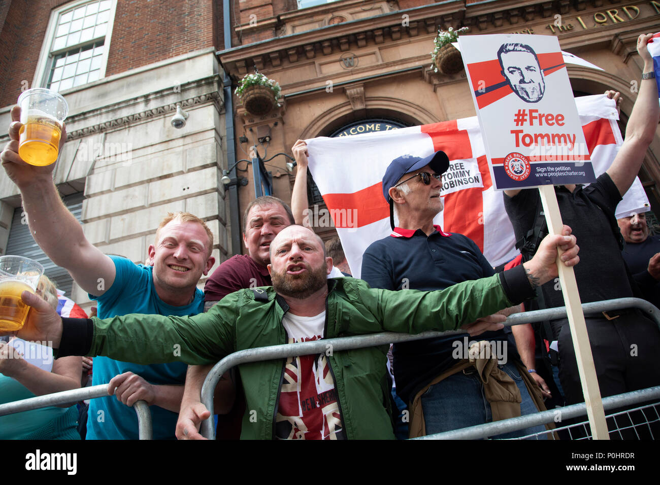 Demonstration calling for the release from jail of former English Defence League, EDL, leader Tommy Robinson on June 9th 2018 in London, England, United Kingdom. Far right groups gathered shouting Free Tommy Robinson, blaming the police for his arrest and calling for free speech. Opposition groups gathered nearby. Credit: Michael Kemp/Alamy Live News - Stock Image