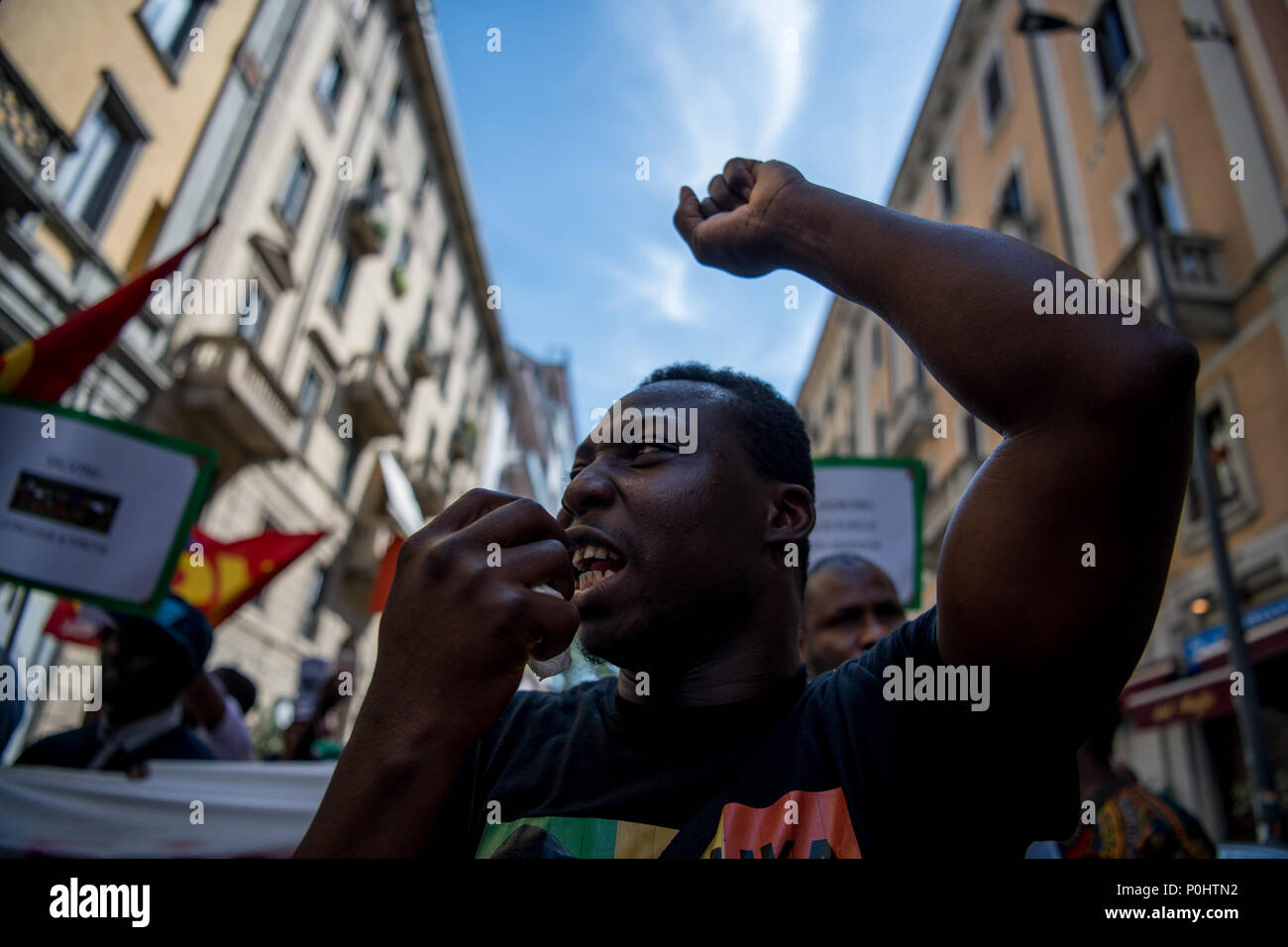 Milan, Italy - 9 June 2018: A man protests during an anti-racist rally against the killing of Soumaila Sacko, a  29 years old Malian farm worker migrant, murdered in a shooting last Sunday in the village of San Ferdinando in the southern Italian region of Calabria. - Stock Image