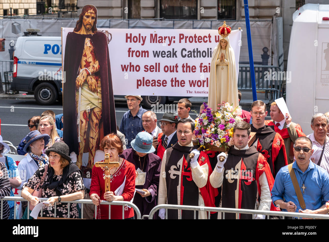 New York, USA. 9th June 2018. A group of ultra conservative Catholics  gather outside the Metropolitan Museum of Art to protest  The Met's 'Heavenly Bodies' Exhibit, which features artifacts donated by the Vatican. The protest was organized by the  American Society for the Defense of Tradition, Family and Property.  Photo by Enrique Shore Credit: Enrique Shore/Alamy Live News - Stock Image