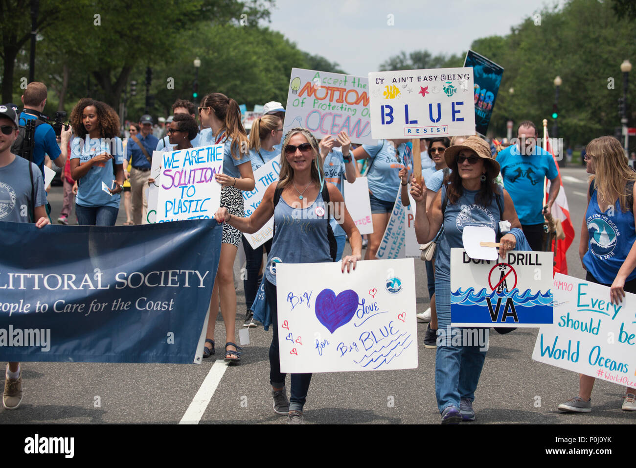 Washington DC, USA. 9th June 2018. Protestors carry signs up 16th Street NW during the March For The Ocean in Washington, D.C., June 9, 2018. The inaugural March for the Ocean called attention to ocean issues including plastic pollution and overfishing at events in the U.S. Capital and around the United States. Credit: Robert Meyers/Alamy Live News - Stock Image