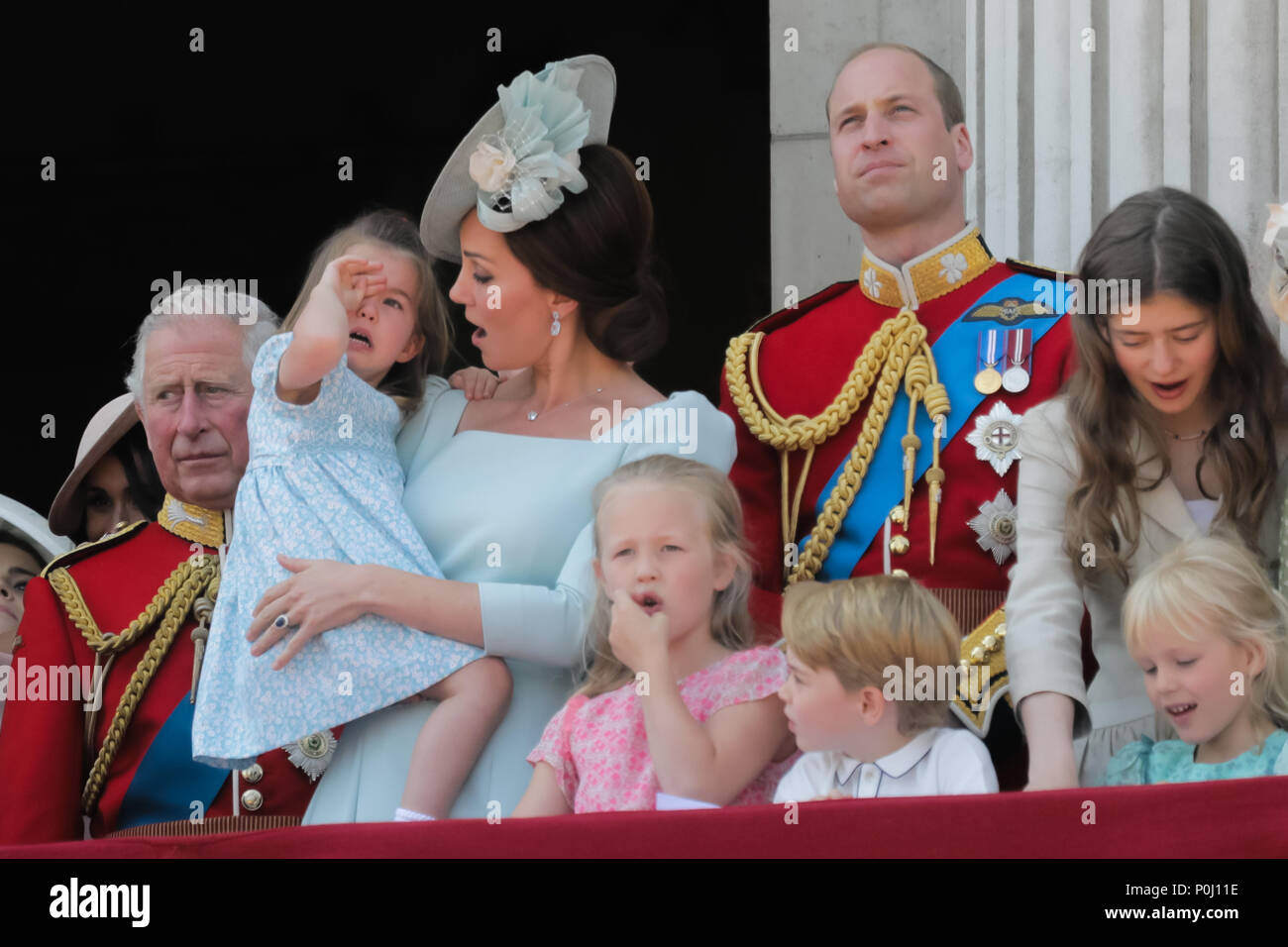 London, UK. 9th June 2018. Prince George looks concerned as his mother, HRH Catherine, Duchess of Cambridge, comforts his tearful sister, Princess Charlotte after she takes a fall on the balcony at Buckingham Palace during the flypast at the end of Trooping the Colour, the Queens Birthday Parade. London Credit: amanda rose/Alamy Live News - Stock Image