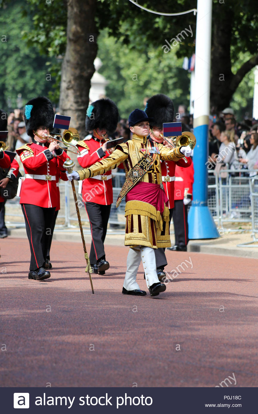London, UK. 9th June, 2018. Drum Major L Rowley of the 1st Battalion Coldstream Guards leading members of the Band of the Irish Guards marching along The Mall. The 2018 Trooping the Colour / Queen's Birthday Parade. Credit: Katie Chan/Alamy Live News Stock Photo
