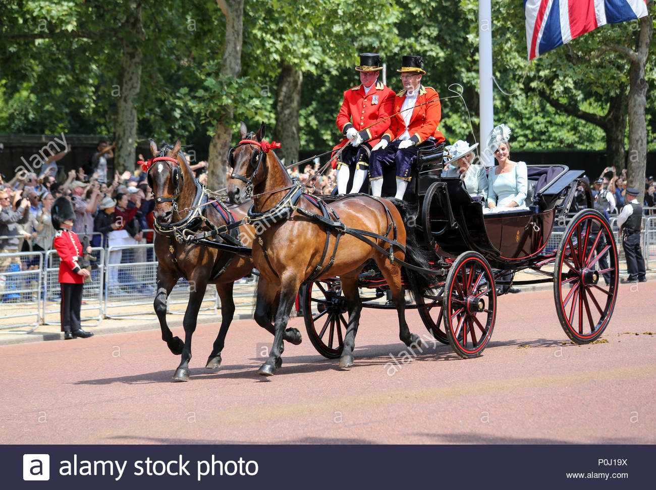 London, UK. 9th June, 2018. Camilla, Duchess of Cornwall & Catherine, Duchess of Cambridge in horse-drawn carriage travelling along The Mall. The 2018 Trooping the Colour / Queen's Birthday Parade. Credit: Katie Chan/Alamy Live News Stock Photo