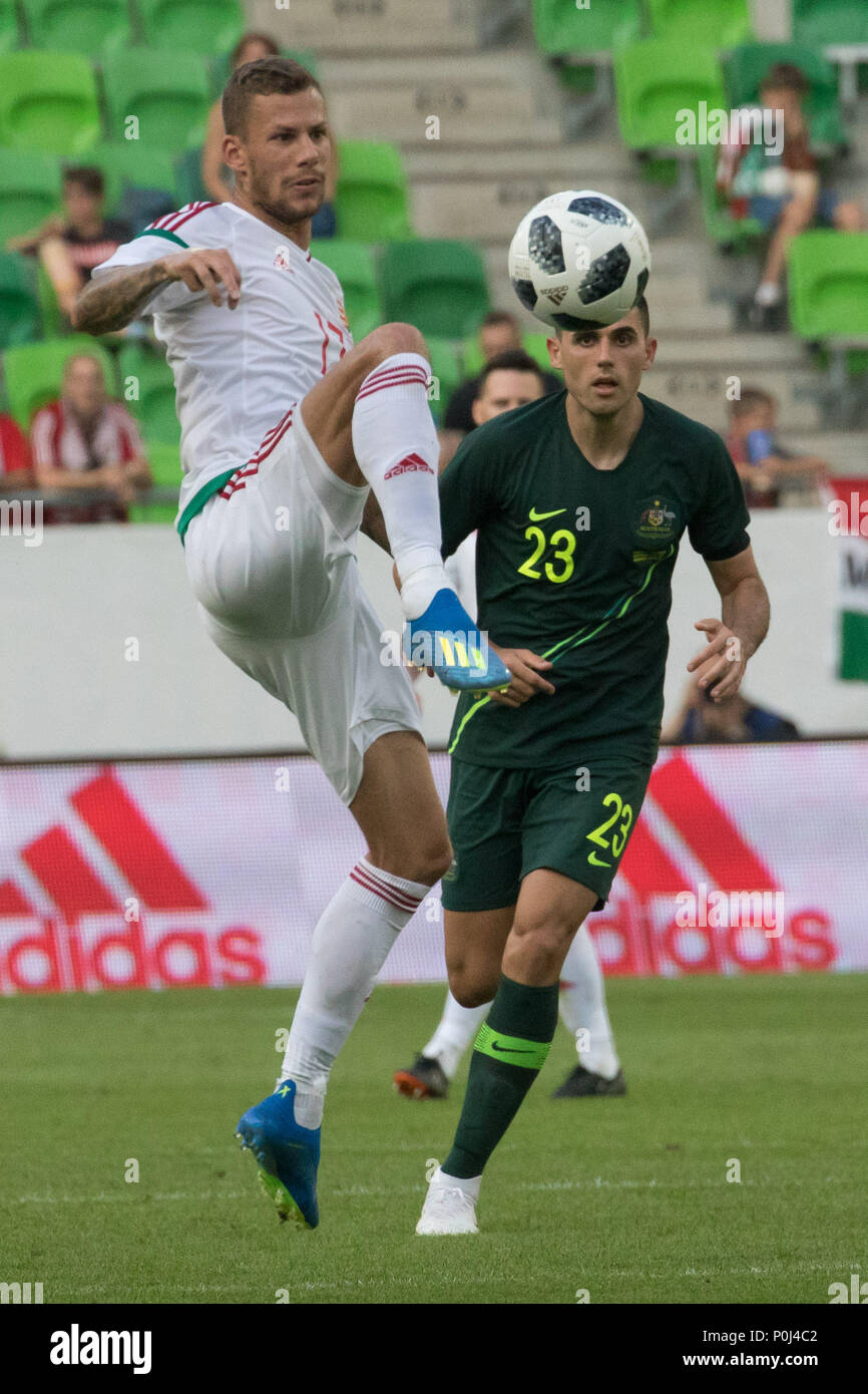Budapest. 9th June, 2018. Roland Varga (L) of Hungary vies with Tom Rogic of Australia during the friendly match at the Groupama Arena in Budapest, Hungary on June 9, 2018. Australia won 2-1. Credit: Attila Volgyi/Xinhua/Alamy Live News - Stock Image