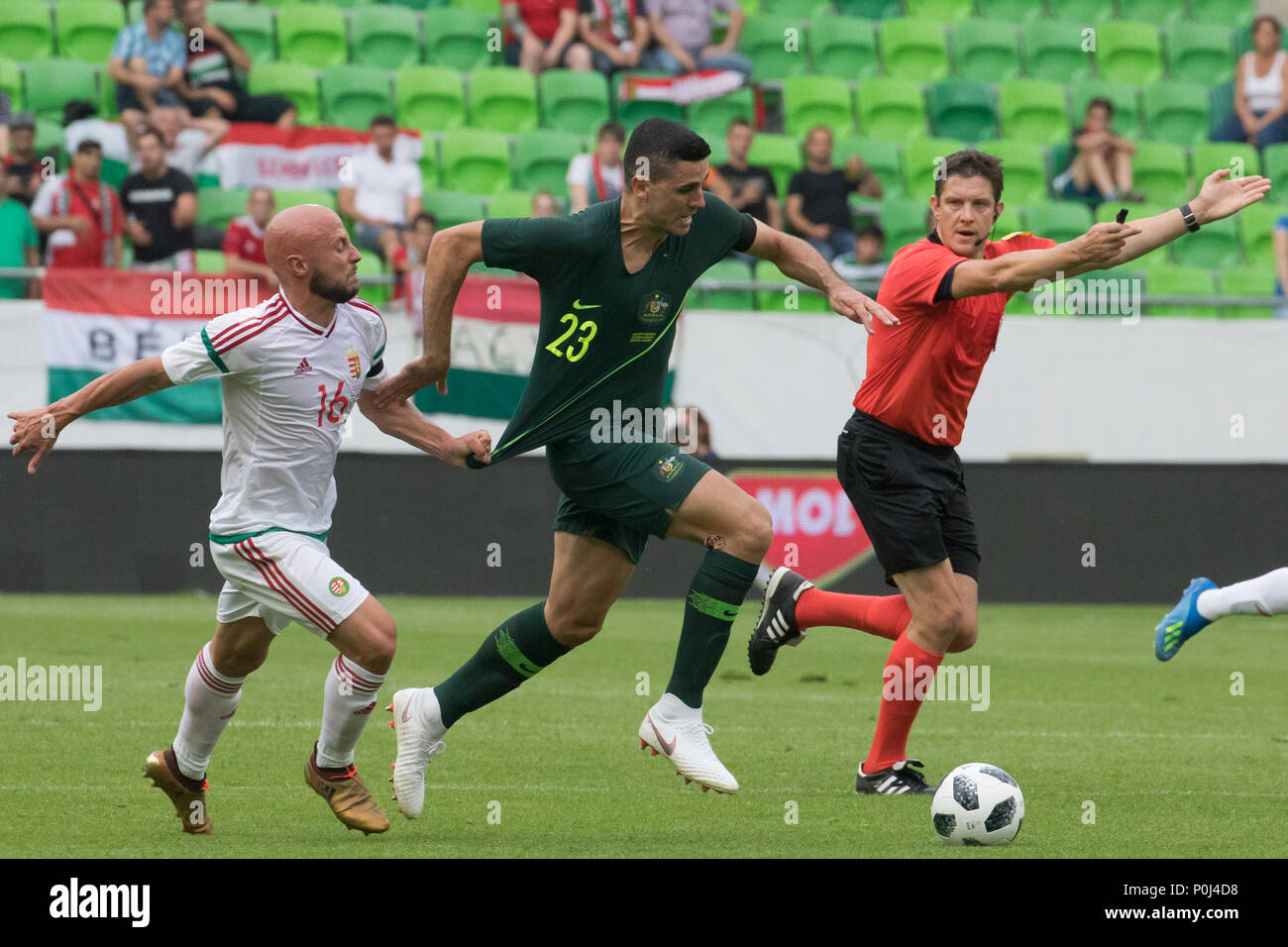 Budapest. 9th June, 2018. Tom Rogic (C) of Australia vies with Jozsef Varga of Hungary during the friendly match at the Groupama Arena in Budapest, Hungary on June 9, 2018. Australia won 2-1. Credit: Attila Volgyi/Xinhua/Alamy Live News - Stock Image