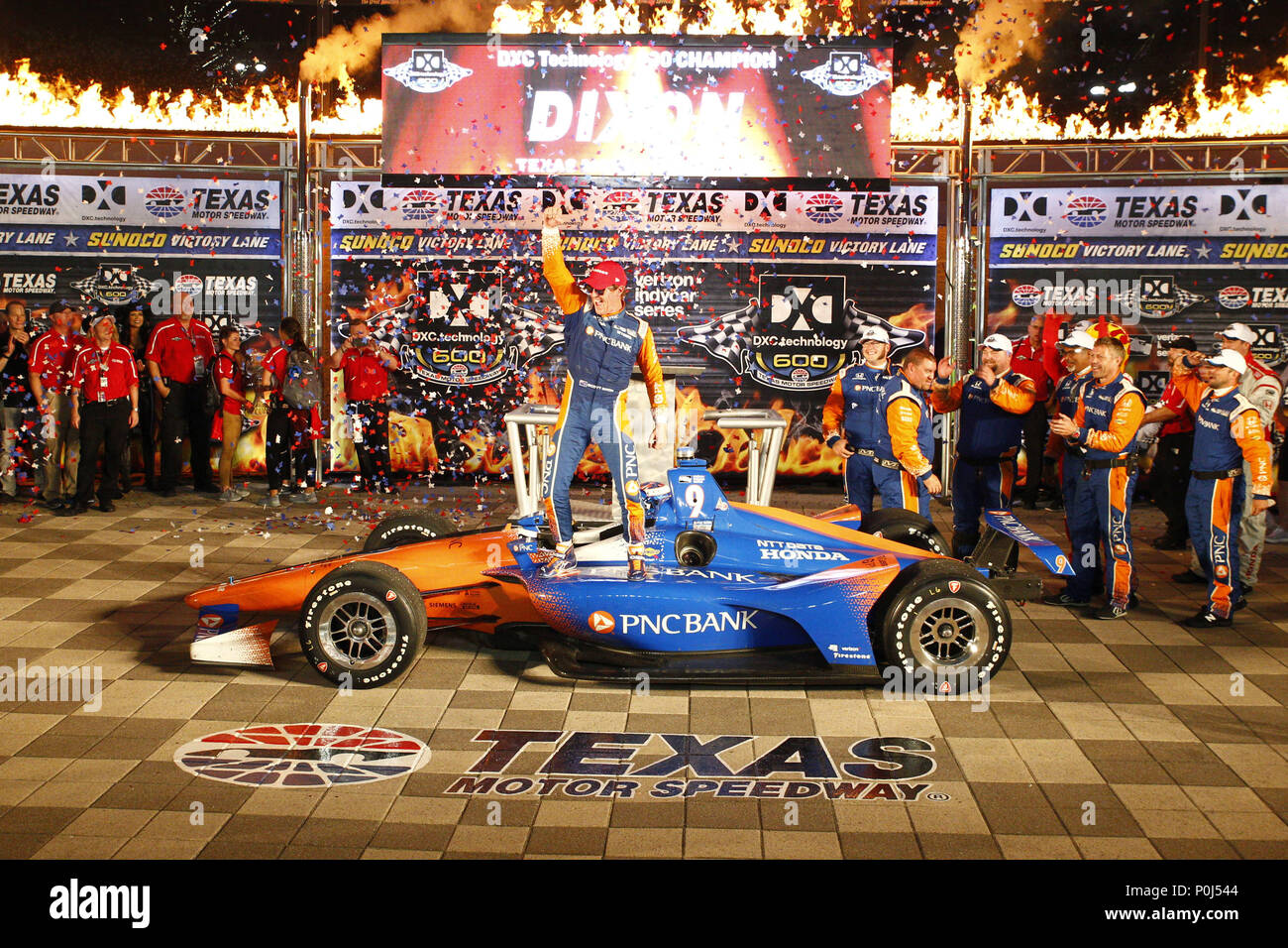 SCOTT DIXON (9) of New Zealand celebrates in victory lane after winning the DXC Technology 600 at Texas Motor Speedway in Fort Worth, Texas.