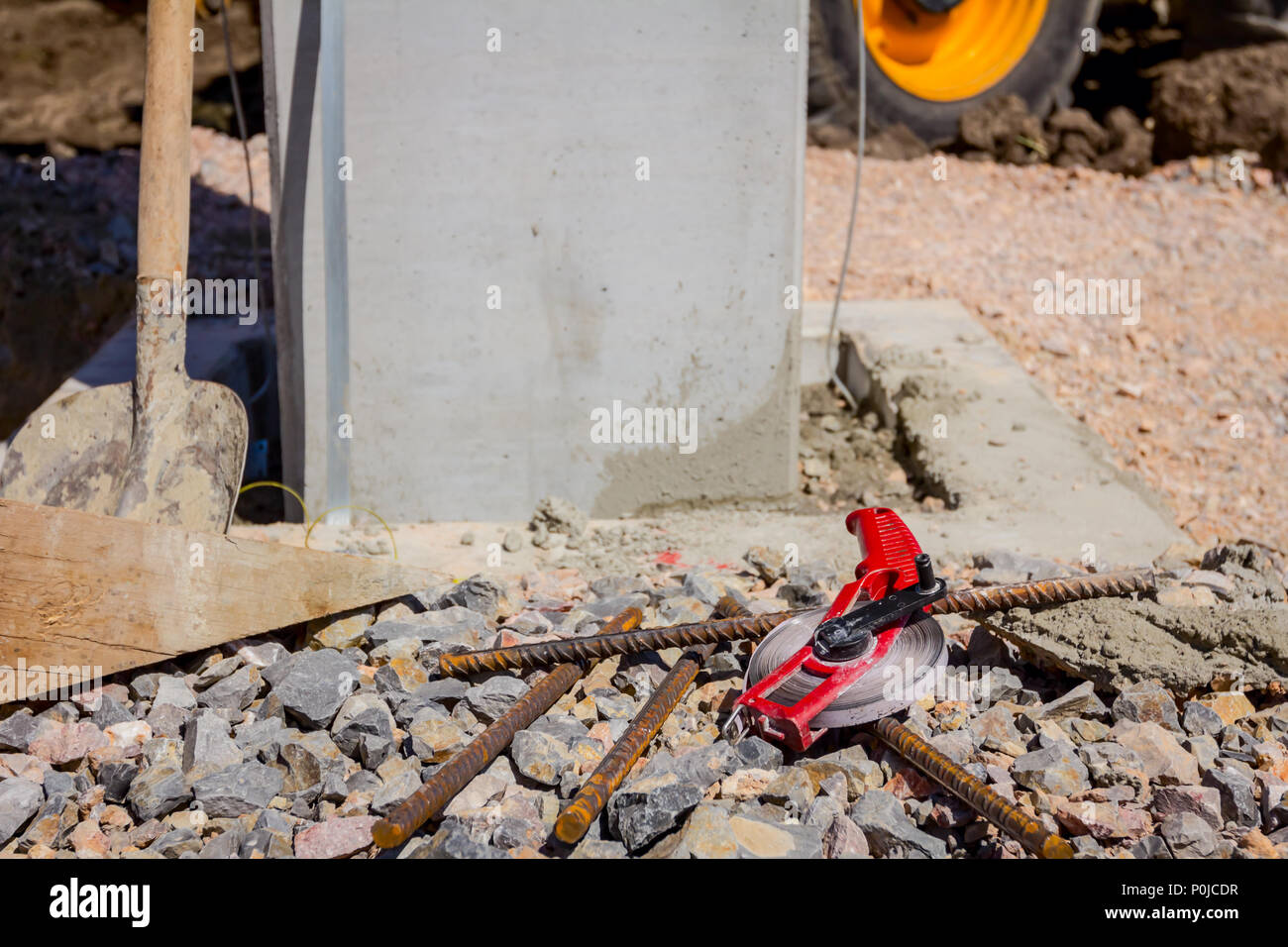 Land measure tape is on the ground after usage for construction site measurement. - Stock Image