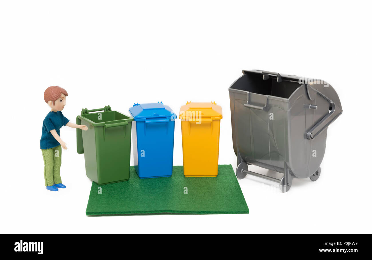 Miniature Man Putting Out Garbage - Stock Image