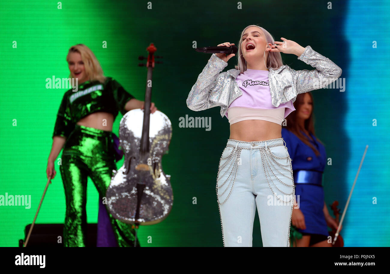 Anne Marie And Grace Chatto Of Clean Bandit On Stage During Capital S Summertime Ball With Vodafone At Wembley Stadium London Stock Photo Alamy