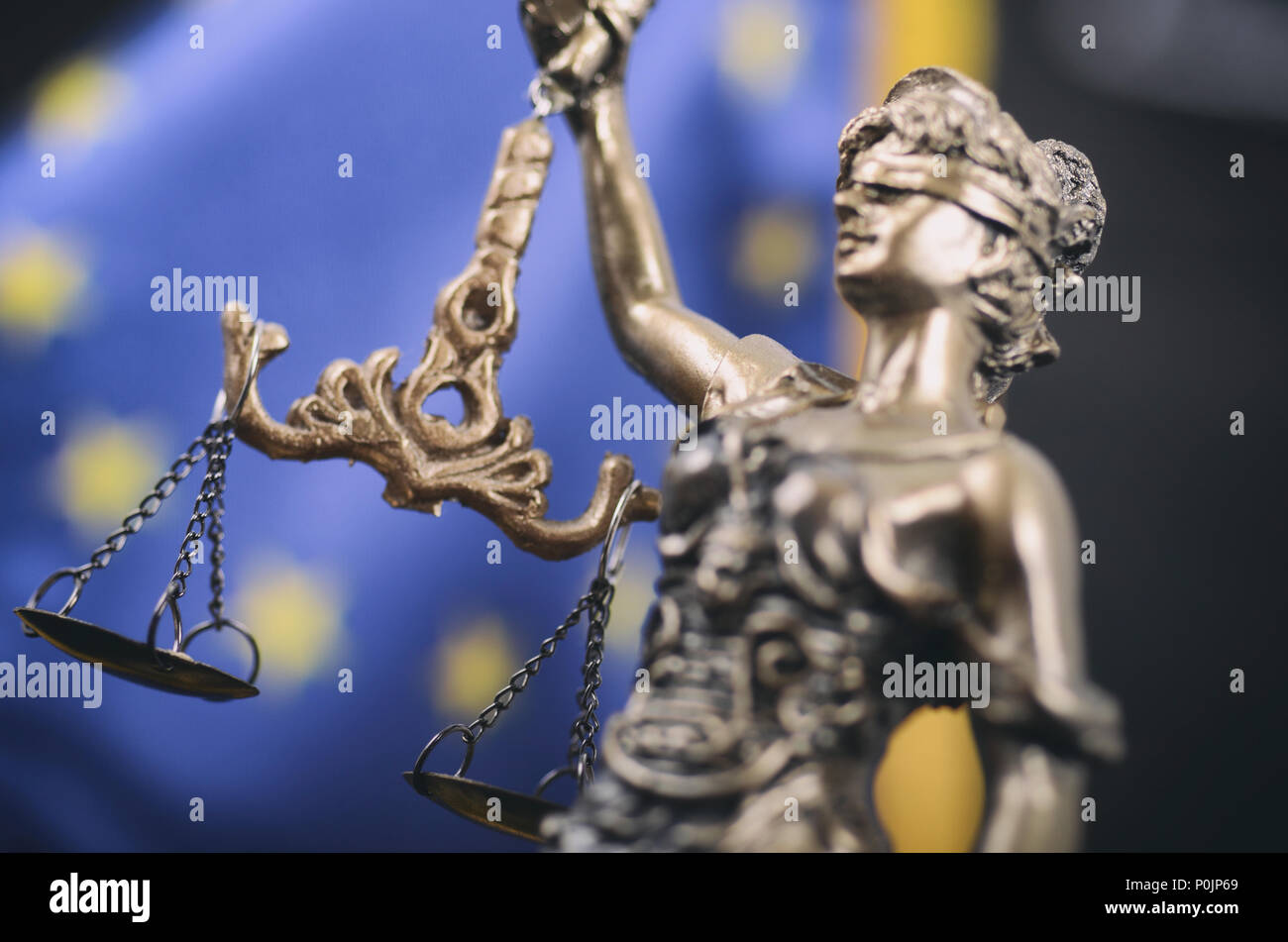 Law and Justice, Legality concept, Scales of Justice, Justitia, Lady Justice in front of the European Union flag in the background. - Stock Image