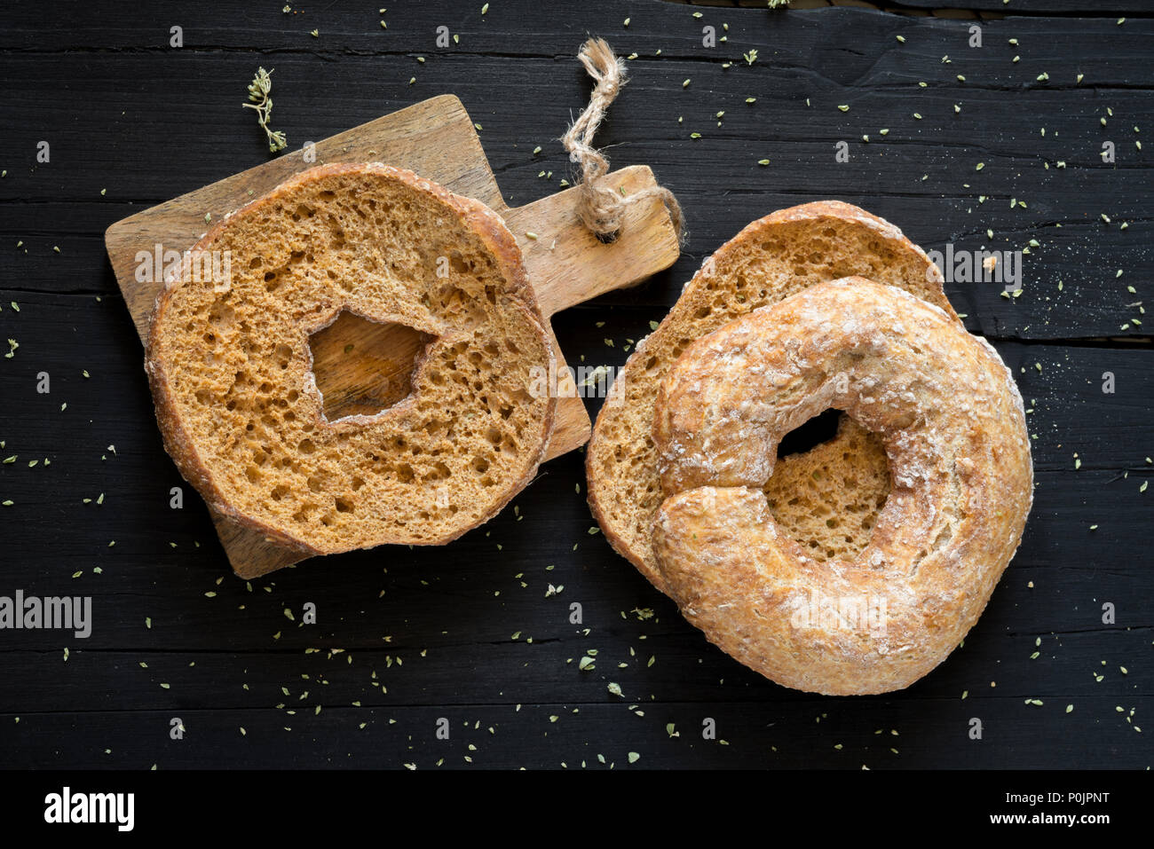 dried bread called freselle, soaked in the water to be served with olive oil and sliced tomato, tuna and olives - Stock Image