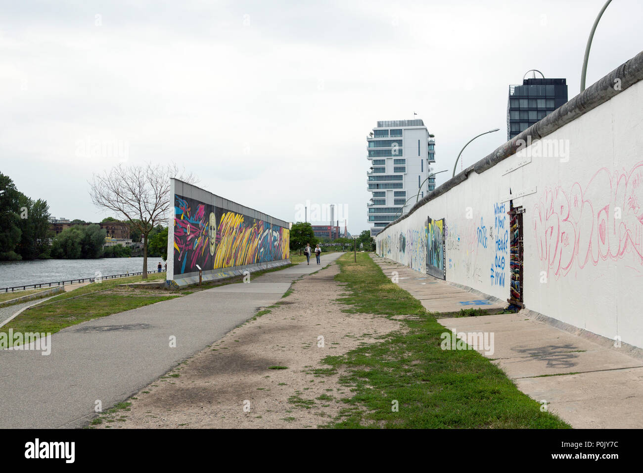 East side Gallery parts of the Wall in Berlin, Germany - Stock Image