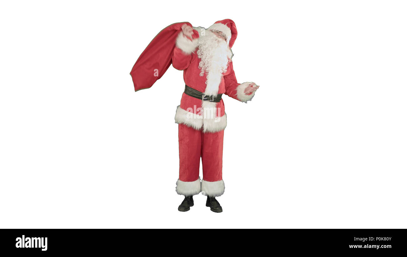 Real Santa Claus carrying big bag full of gifts on white background - Stock Image