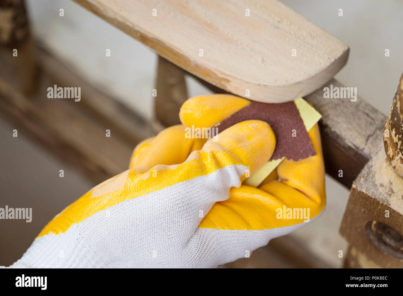 Sanding The Paint Of An Old Furniture - Stock Image