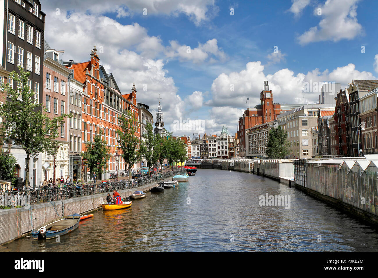 Wide angle photo from Flower Market (Bloemenmarkt), the world's only floating flower market founded in 1862, attracting many tourist from the world. Stock Photo