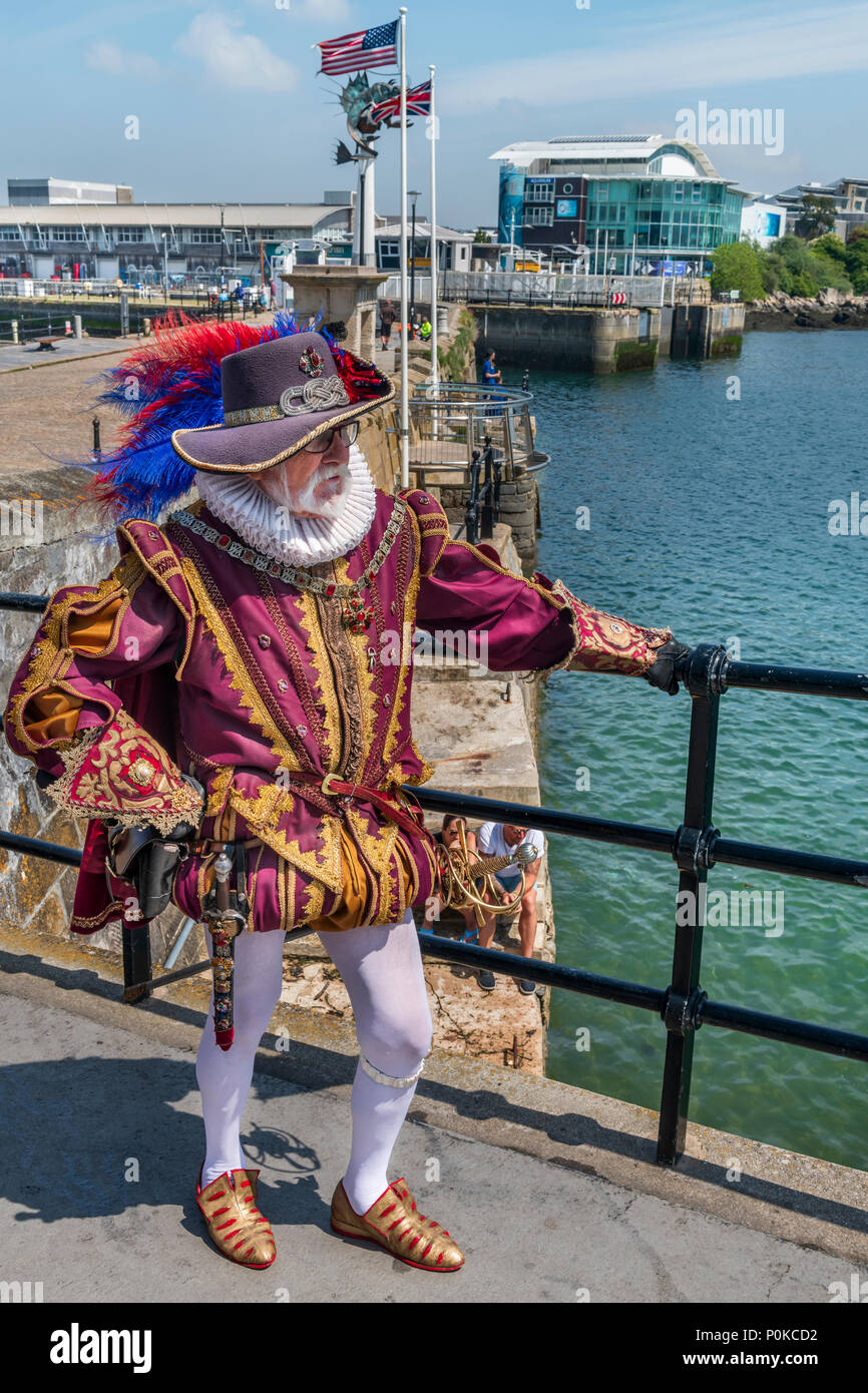 A man in Doublet and Hose poses close to the Mayflower Steps in Plymouth, England. Although not the actual site where the Pilgrim Father's departed, i - Stock Image