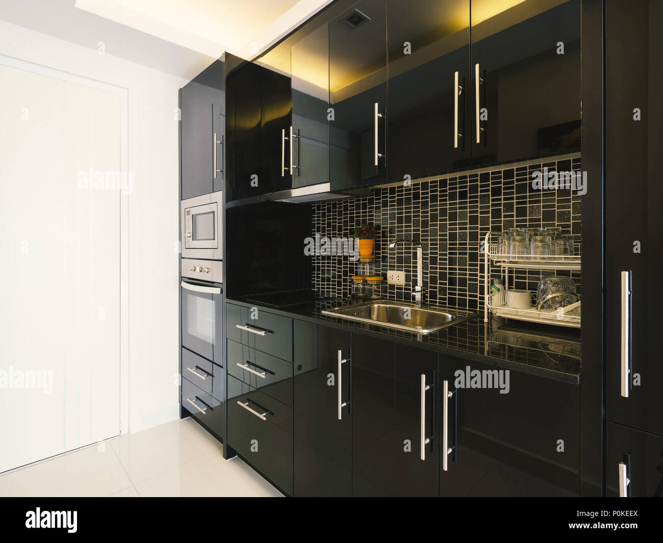 Modern Style Kitchen Interior In Modern Home With Black Color Ceramic And  Stainless Steel Appliances
