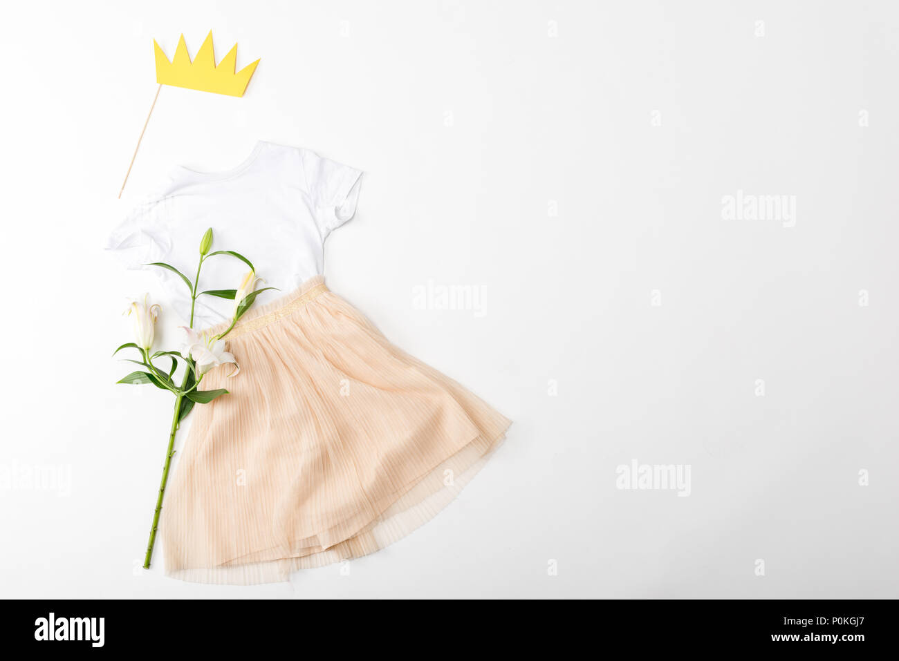 White Shirt Beige Skirt With Flowers And Paper Crown On Stick