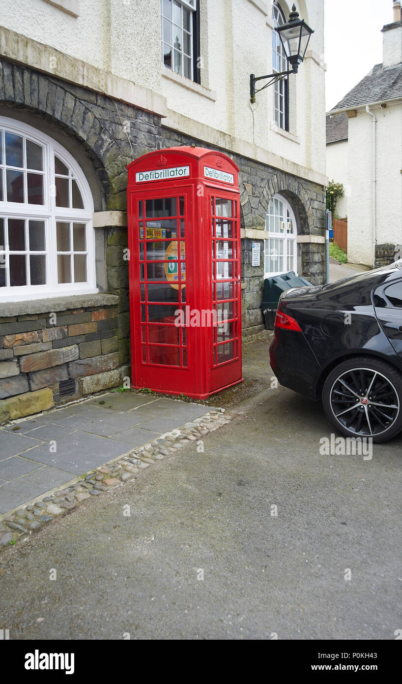 Woman parked her Jaguar car so as to block emergency access to the village defibrillator in Hawkshead  cumbria, The Lake District National Park UK GB - Stock Image