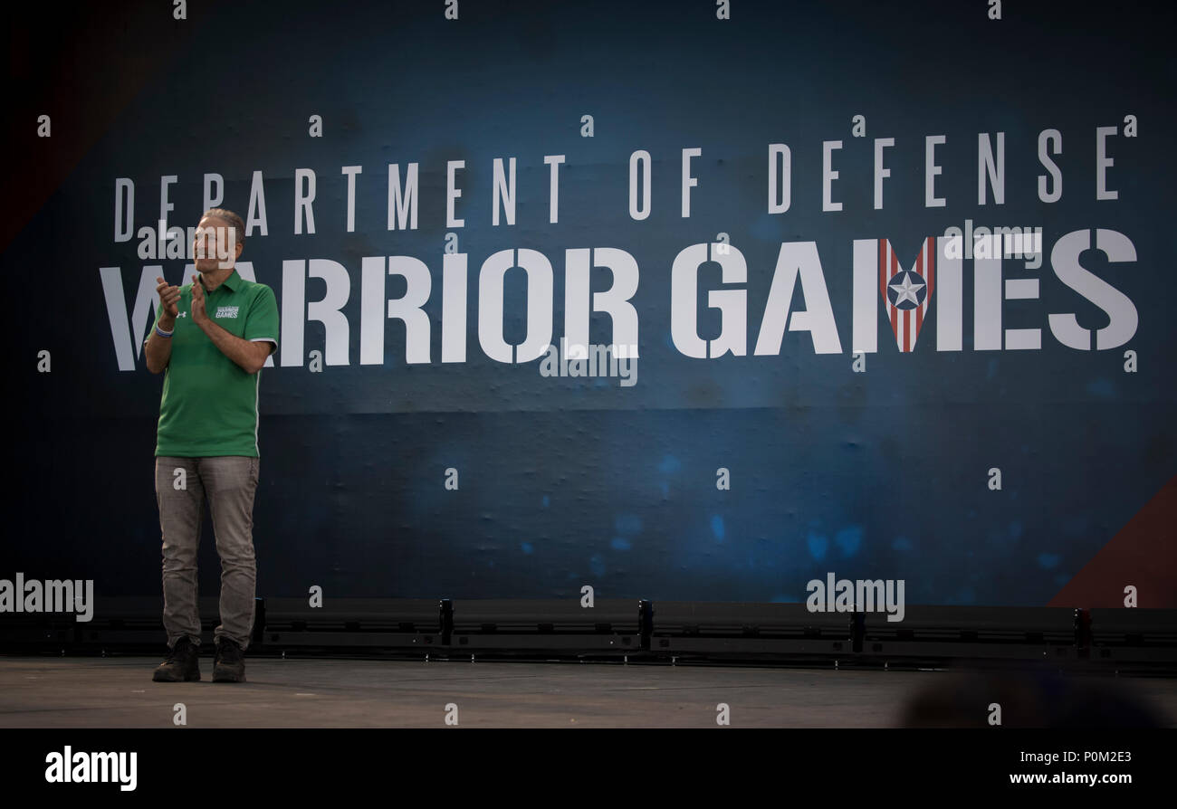 Jon Stewart, television personality and host of the Department of Defense Warrior Games Opening Ceremony, stands on stage during the event in Colorado Springs, Colorado, June 2, 2018.  First held in Colorado Springs in 2010, the Warrior Games were established as a way to enhance the recovery and rehabilitation of wounded, ill, and injured service members and expose them to adaptive sports. This year, the Games have returned to Colorado Springs, with the Air Force acting as the host service. (U.S. Air Force Photo by Senior Airman Dennis Hoffman) - Stock Image