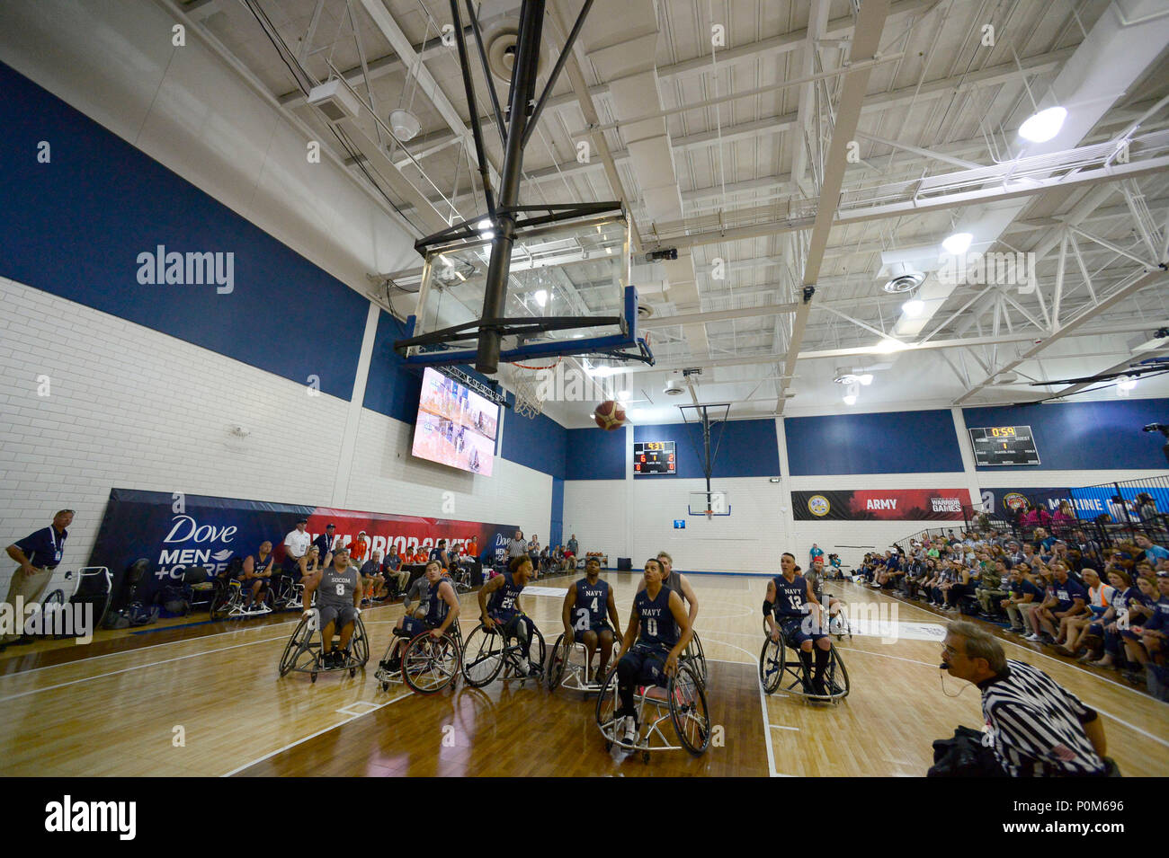 Team SOCOM plays Navy in wheelchair basketball during the 2018 Warrior Games held at the Air Force Academy in Colorado Springs June 4, 2018. Several members of Team SOCOM advanced to the finals. Created in 2010, the DoD Warrior Games introduce wounded, ill and injured service members and veterans to Paralympic-style sports. Warrior Games showcases the resilient spirit of today's wounded, ill or injured service members from all branches of the military. These athletes have overcome significant physical and behavioral injuries and prove that life can continue after becoming wounded, ill or injur - Stock Image