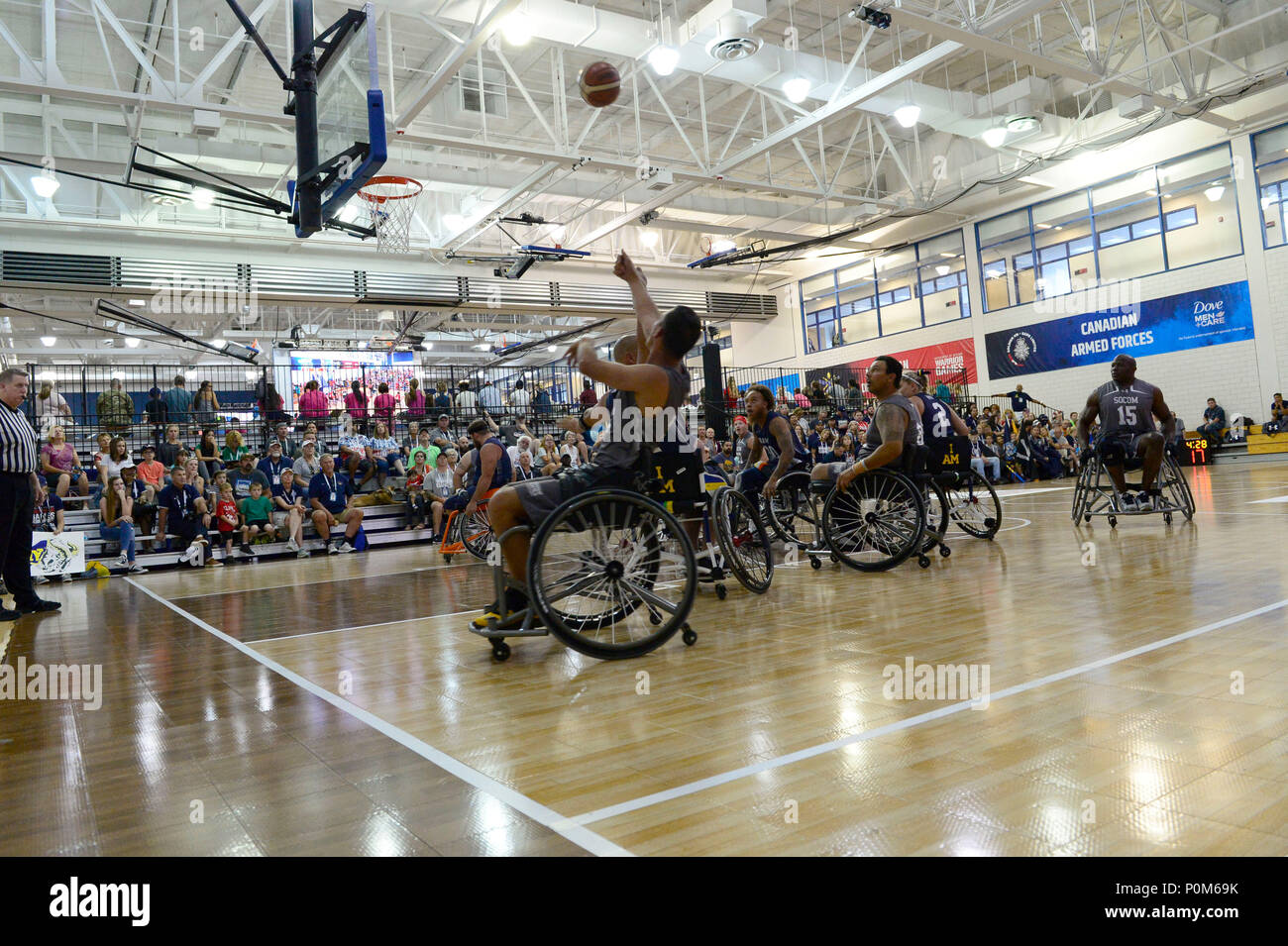 Army Spc. Vairon Caicedo Ocampo from Team SOCOM takes a shot against Navy in the wheelchair basketball game during the 2018 Warrior Games held at the Air Force Academy in Colorado Springs June 4, 2018.  Created in 2010, the DoD Warrior Games introduce wounded, ill and injured service members and veterans to Paralympic-style sports. Warrior Games showcases the resilient spirit of today's wounded, ill or injured service members from all branches of the military. These athletes have overcome significant physical and behavioral injuries and prove that life can continue after becoming wounded, ill  Stock Photo