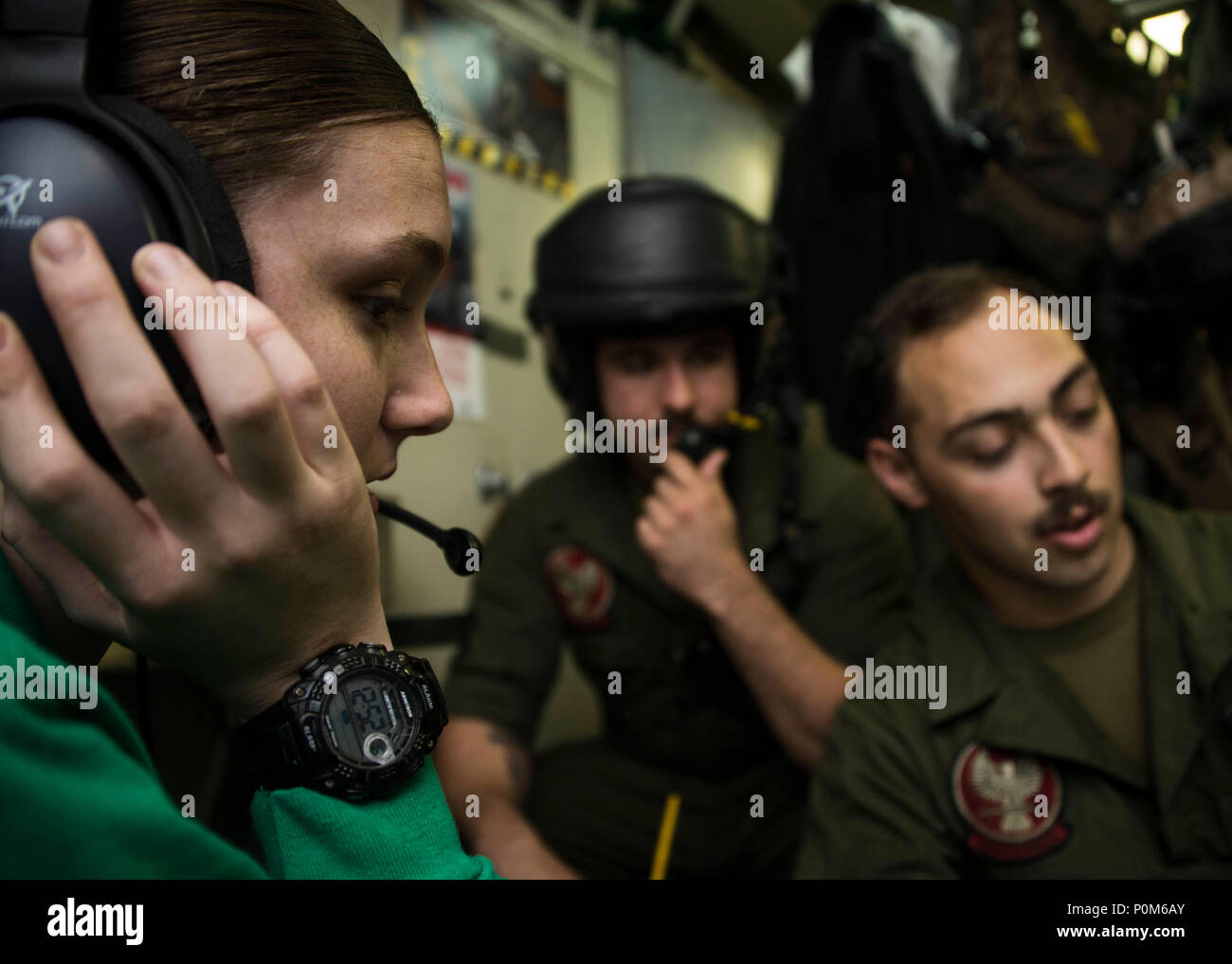 180605-N-ZG607-0043  U.S. 5th FLEET AREA OF OPERATIONS (June 5, 2018) Aircrew Survival Equipmentman 3rd Class Brittaney Spicer, assigned to Helicopter Sea Combat Squadron (HSC) 28, troubleshoots communications and breathing functionality on the HGU-84/P aviators helmet in the flight equipment work center aboard the Wasp-class amphibious assault ship USS Iwo Jima (LHD 7), June 5, 2018. Iwo Jima, homeported in Mayport, Fla., is on deployment to the U.S. 5th Fleet area of operations in support of maritime security operations to reassure allies and partners, and preserve the freedom of navigation  Stock Photo