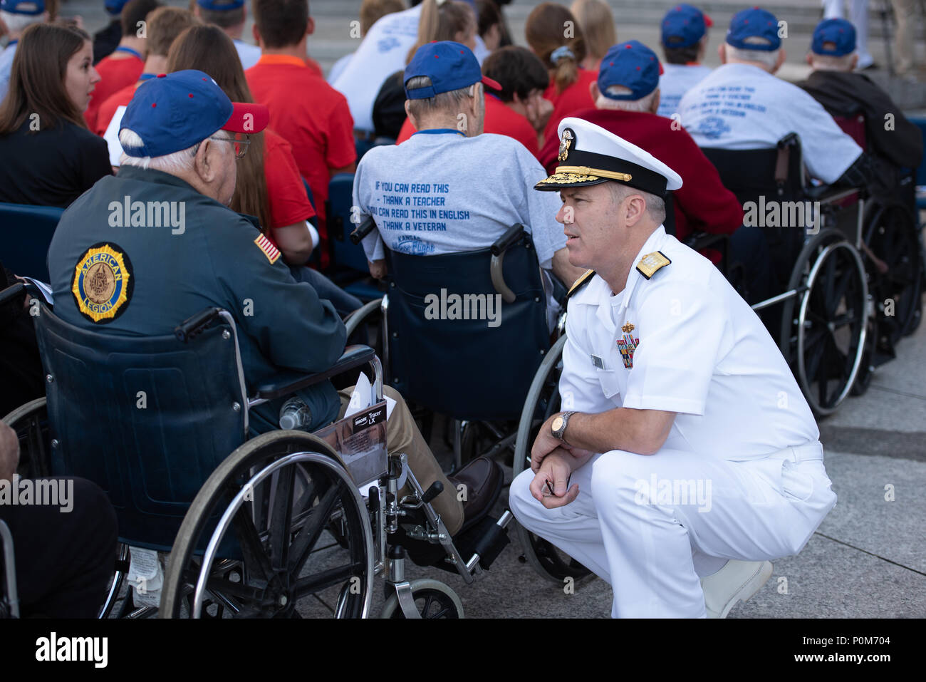 180605-N-HG258-1009 WASHINGTON (June 5, 2018) Rear Adm. Ronald Boxall meets with members of an Honor Flight from Kansas at the U.S. Navy Memorial in Washington, D.C., before the commemoration of the 76th anniversary of the Battle of Midway. The Battle of Midway began on June 4 in 1942 and stands as one of the U.S. Navy's most historically significant naval battles. Fought on the high seas of the Pacific more than half a century ago, this battle altered the course of the war in the Pacific and thereby shaped the outcome of world events. (U.S. Navy photo by Senior Chief Musician Stephen Hassay/R - Stock Image