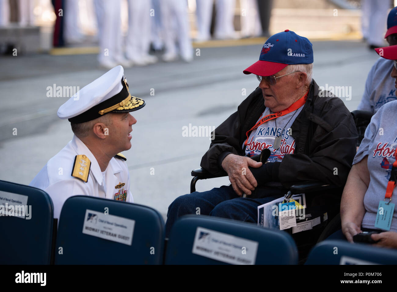 180605-N-HG258-1031 WASHINGTON (June 5, 2018) Rear Adm. Ronald Boxall meets with members of an Honor Flight from Kansas at the U.S. Navy Memorial in Washington, D.C., before the commemoration of the 76th anniversary of the Battle of Midway. The Battle of Midway began on June 4 in 1942 and stands as one of the U.S. Navy's most historically significant naval battles. Fought on the high seas of the Pacific more than half a century ago, this battle altered the course of the war in the Pacific and thereby shaped the outcome of world events. (U.S. Navy photo by Senior Chief Musician Stephen Hassay/R - Stock Image