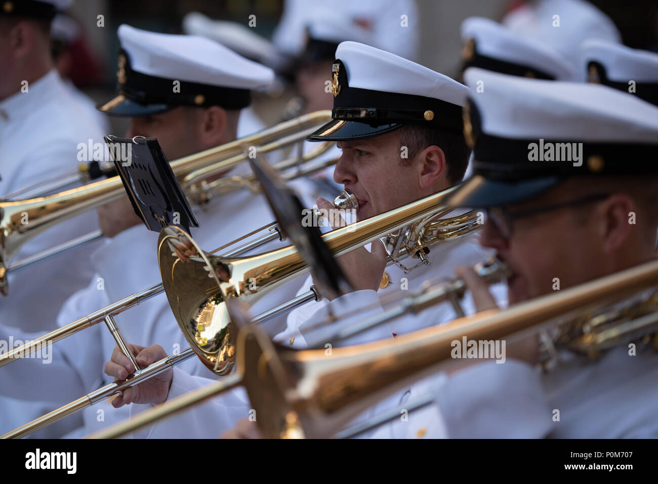 180605-N-HG258-1036 WASHINGTON (June 5, 2018) Musician 1st Class Ken Moses, trombone instrumentalist with the U.S. Navy Ceremonial band performs at the U.S. Navy Memorial in Washington, D.C., during the commemoration of the 76th anniversary of the Battle of Midway. The Battle of Midway began on June 4 in 1942 and stands as one of the U.S. Navy's most historically significant naval battles. Fought on the high seas of the Pacific more than half a century ago, this battle altered the course of the war in the Pacific and thereby shaped the outcome of world events. (U.S. Navy photo by Senior Chief  - Stock Image