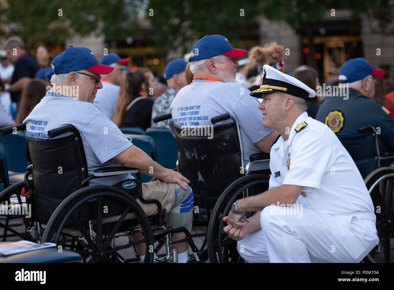 180605-N-HG258-1018 WASHINGTON (June 5, 2018) Rear Adm. Ronald Boxall meets with members of an Honor Flight from Kansas at the U.S. Navy Memorial in Washington, D.C., before the commemoration of the 76th anniversary of the Battle of Midway. The Battle of Midway began on June 4 in 1942 and stands as one of the U.S. Navy's most historically significant naval battles. Fought on the high seas of the Pacific more than half a century ago, this battle altered the course of the war in the Pacific and thereby shaped the outcome of world events. (U.S. Navy photo by Senior Chief Musician Stephen Hassay/R - Stock Image