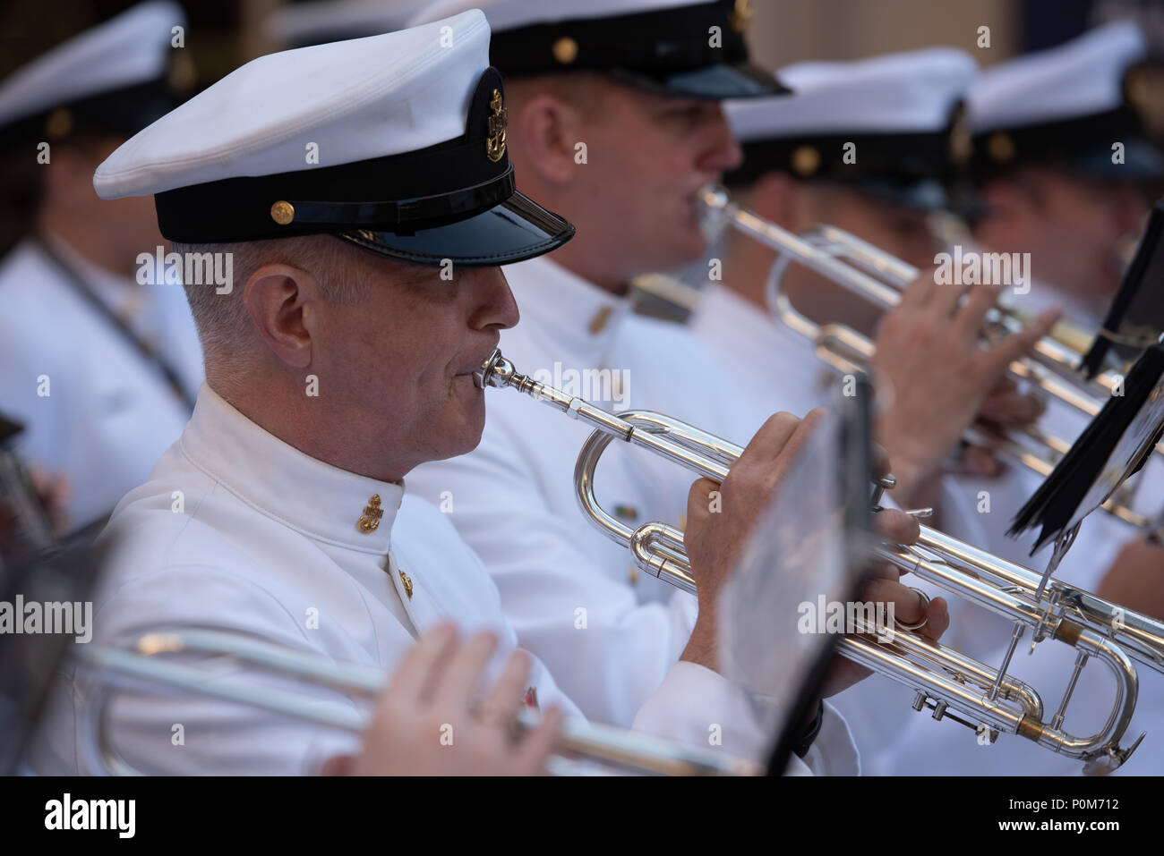 180605-N-HG258-1046 WASHINGTON (June 5, 2018) Chief Musician Stanley Curtis, trumpet instrumentalist with the U.S. Navy Ceremonial band performs at the U.S. Navy Memorial in Washington, D.C., during the commemoration of the 76th anniversary of the Battle of Midway. The Battle of Midway began on June 4 in 1942 and stands as one of the U.S. Navy's most historically significant naval battles. Fought on the high seas of the Pacific more than half a century ago, this battle altered the course of the war in the Pacific and thereby shaped the outcome of world events. (U.S. Navy photo by Senior Chief  - Stock Image