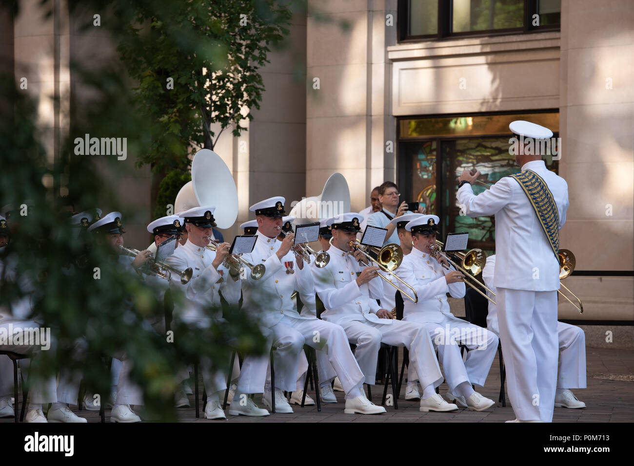 180605-N-HG258-1051 WASHINGTON (June 5, 2018) Members of the U.S. Navy Ceremonial band perform ceremonial music at the U.S. Navy Memorial in Washington, D.C., during the commemoration of the 76th anniversary of the Battle of Midway. The Battle of Midway began on June 4 in 1942 and stands as one of the U.S. Navy's most historically significant naval battles. Fought on the high seas of the Pacific more than half a century ago, this battle altered the course of the war in the Pacific and thereby shaped the outcome of world events. (U.S. Navy photo by Senior Chief Musician Stephen Hassay/Released) - Stock Image