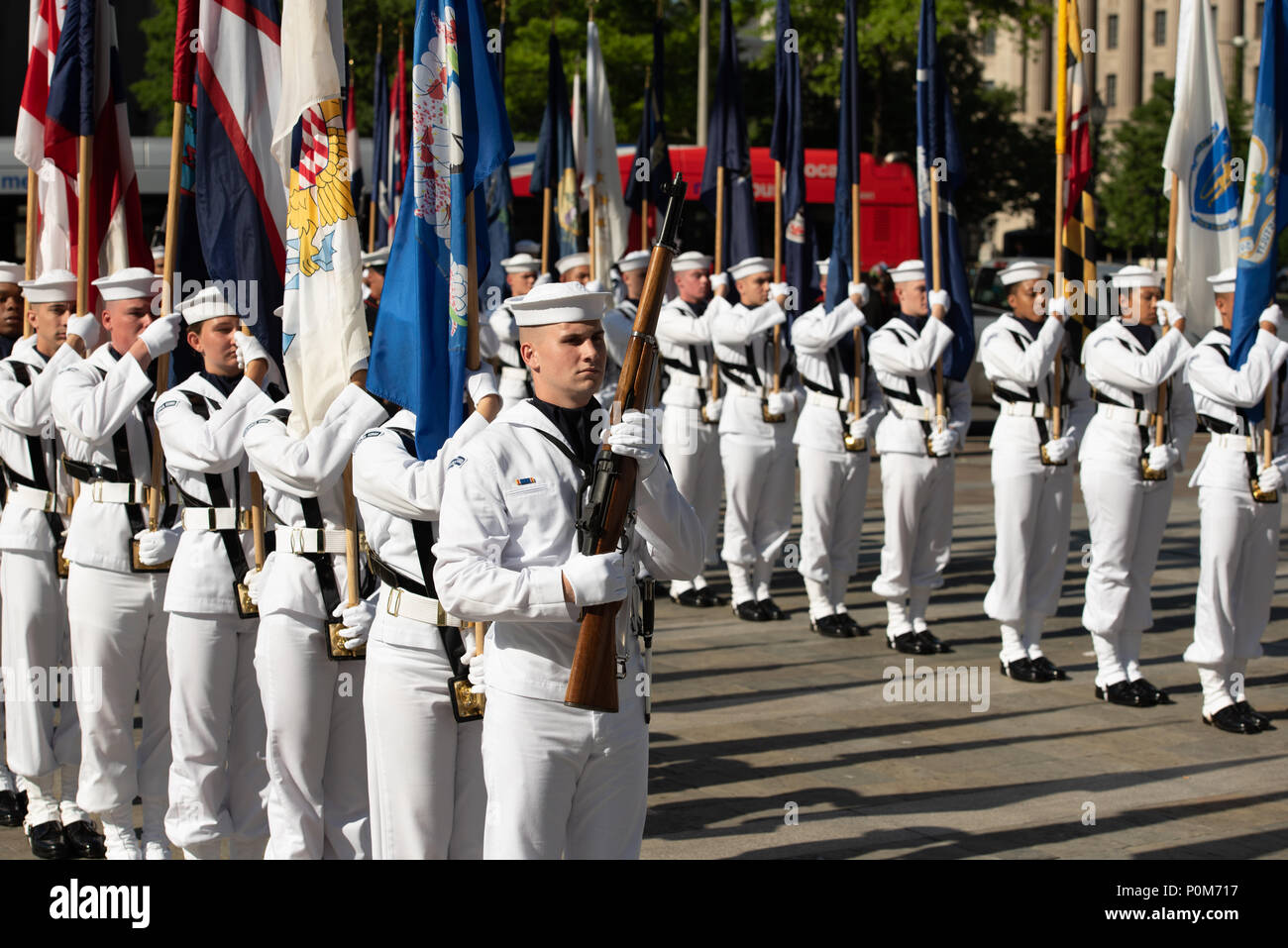 180605-N-HG258-1057 WASHINGTON (June 5, 2018) Members of the U.S. Navy Ceremonial guard march onto the U.S. Navy Memorial in Washington, D.C., during the commemoration of the 76th anniversary of the Battle of Midway. The Battle of Midway began on June 4 in 1942 and stands as one of the U.S. Navy's most historically significant naval battles. Fought on the high seas of the Pacific more than half a century ago, this battle altered the course of the war in the Pacific and thereby shaped the outcome of world events. (U.S. Navy photo by Senior Chief Musician Stephen Hassay/Released) - Stock Image
