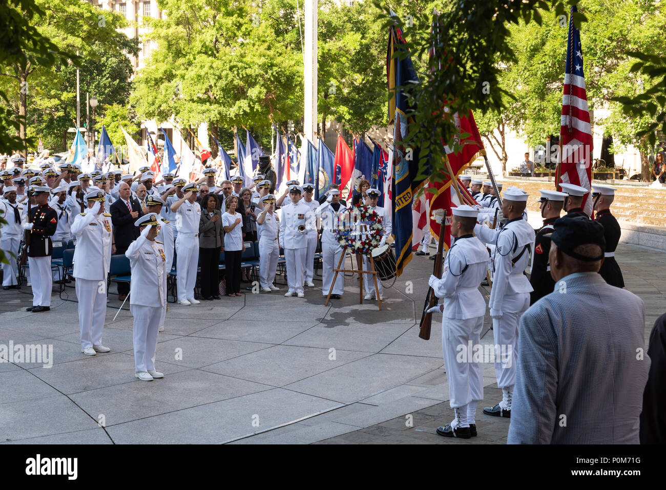180605-N-HG258-1089 WASHINGTON (June 5, 2018) The Vice Chief of Naval Operations, Adm. Bill Moran lays a wreath at the U.S. Navy Memorial in Washington, D.C., during the commemoration of the 76th anniversary of the Battle of Midway. The Battle of Midway began on June 4 in 1942 and stands as one of the U.S. Navy's most historically significant naval battles. Fought on the high seas of the Pacific more than half a century ago, this battle altered the course of the war in the Pacific and thereby shaped the outcome of world events. (U.S. Navy photo by Senior Chief Musician Stephen Hassay/Released) - Stock Image
