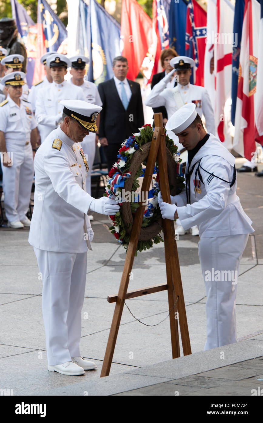 180605-N-HG258-1095 WASHINGTON (June 5, 2018) The Vice Chief of Naval Operations, Adm. Bill Moran lays a wreath at the U.S. Navy Memorial in Washington, D.C., during the commemoration of the 76th anniversary of the Battle of Midway. The Battle of Midway began on June 4 in 1942 and stands as one of the U.S. Navy's most historically significant naval battles. Fought on the high seas of the Pacific more than half a century ago, this battle altered the course of the war in the Pacific and thereby shaped the outcome of world events. (U.S. Navy photo by Senior Chief Musician Stephen Hassay/Released) - Stock Image