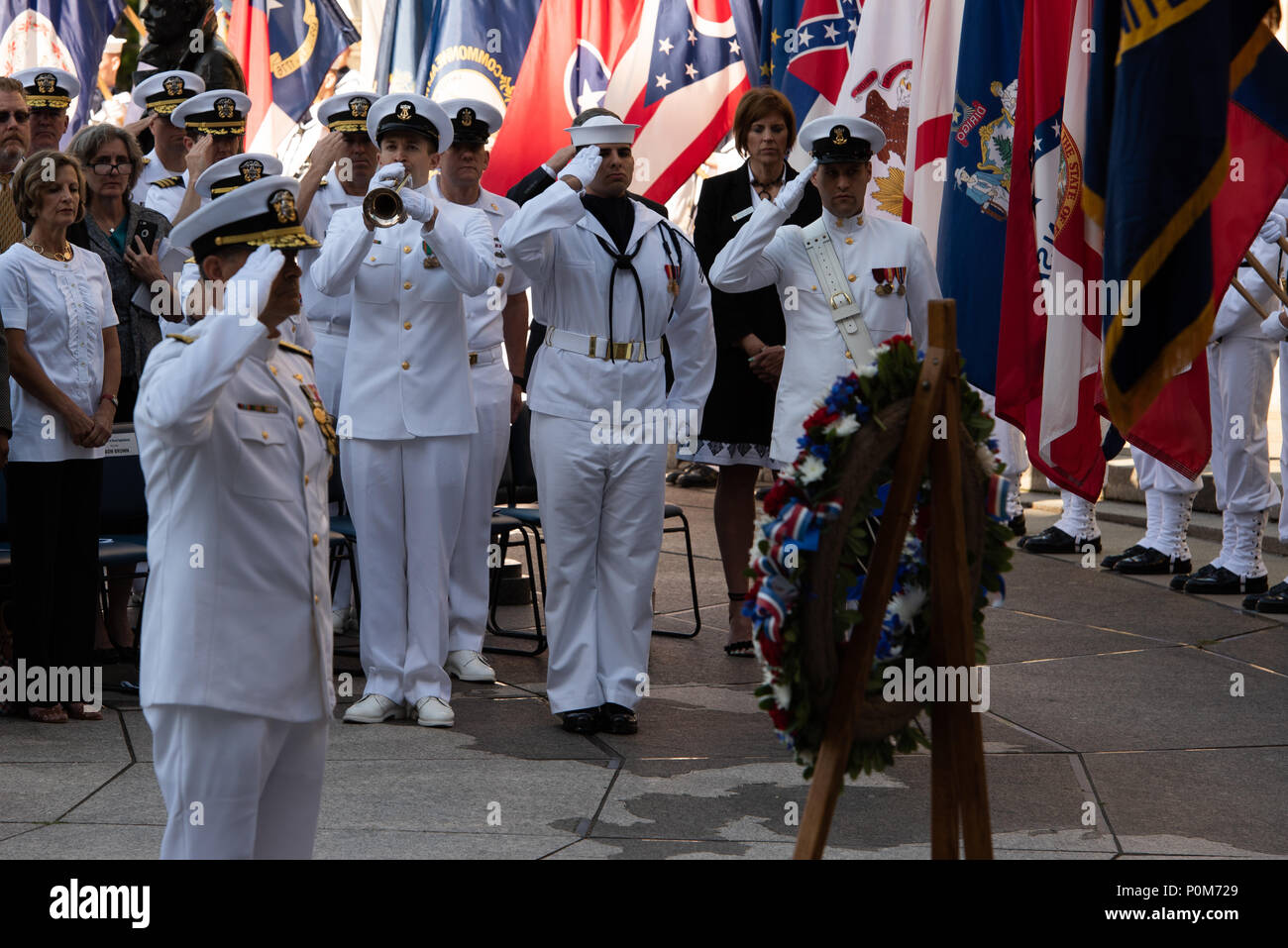 180605-N-HG258-1101 WASHINGTON (June 5, 2018) The Vice Chief of Naval Operations, Adm. Bill Moran lays a wreath at the U.S. Navy Memorial in Washington, D.C., during the commemoration of the 76th anniversary of the Battle of Midway. The Battle of Midway began on June 4 in 1942 and stands as one of the U.S. Navy's most historically significant naval battles. Fought on the high seas of the Pacific more than half a century ago, this battle altered the course of the war in the Pacific and thereby shaped the outcome of world events. (U.S. Navy photo by Senior Chief Musician Stephen Hassay/Released) - Stock Image