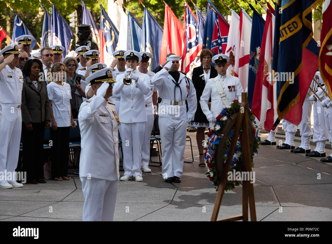 180605-N-HG258-1098 WASHINGTON (June 5, 2018) The Vice Chief of Naval Operations, Adm. Bill Moran lays a wreath at the U.S. Navy Memorial in Washington, D.C., during the commemoration of the 76th anniversary of the Battle of Midway. The Battle of Midway began on June 4 in 1942 and stands as one of the U.S. Navy's most historically significant naval battles. Fought on the high seas of the Pacific more than half a century ago, this battle altered the course of the war in the Pacific and thereby shaped the outcome of world events. (U.S. Navy photo by Senior Chief Musician Stephen Hassay/Released) - Stock Image