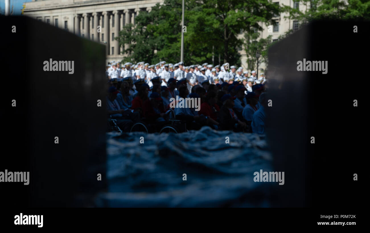180605-N-HG258-1148 WASHINGTON (June 5, 2018) Members of the U.S. Navy Ceremonial band perform ceremonial music at the U.S. Navy Memorial in Washington, D.C., during the commemoration of the 76th anniversary of the Battle of Midway. The Battle of Midway began on June 4 in 1942 and stands as one of the U.S. Navy's most historically significant naval battles. Fought on the high seas of the Pacific more than half a century ago, this battle altered the course of the war in the Pacific and thereby shaped the outcome of world events. (U.S. Navy photo by Senior Chief Musician Stephen Hassay/Released) - Stock Image