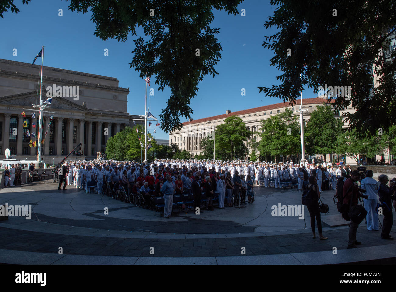 180605-N-HG258-1000 WASHINGTON (June 5, 2018) Members of the U.S. Navy Ceremonial band perform ceremonial music at the U.S. Navy Memorial in Washington, D.C., during the commemoration of the 76th anniversary of the Battle of Midway. The Battle of Midway began on June 4 in 1942 and stands as one of the U.S. Navy's most historically significant naval battles. Fought on the high seas of the Pacific more than half a century ago, this battle altered the course of the war in the Pacific and thereby shaped the outcome of world events. (U.S. Navy photo by Senior Chief Musician Stephen Hassay/Released) - Stock Image