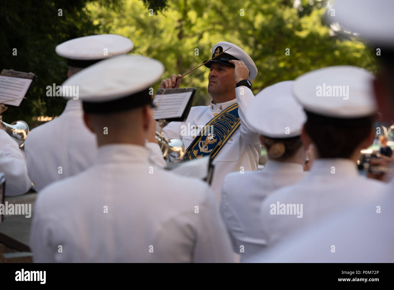 180605-N-HG258-1000 WASHINGTON (June 5, 2018) Senior Chief Musician Michael Bayes, drum major of the U.S. Navy Ceremonial band leads the band at the U.S. Navy Memorial in Washington, D.C., during the commemoration of the 76th anniversary of the Battle of Midway. The Battle of Midway began on June 4 in 1942 and stands as one of the U.S. Navy's most historically significant naval battles. Fought on the high seas of the Pacific more than half a century ago, this battle altered the course of the war in the Pacific and thereby shaped the outcome of world events. (U.S. Navy photo by Senior Chief Mus - Stock Image