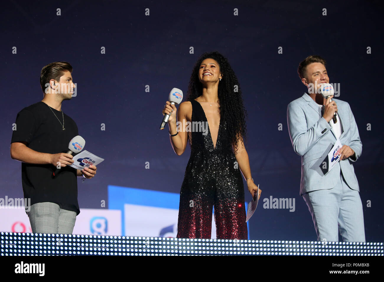 Vick Hope, Roman Kemp (right) and Sonny Jay on stage during