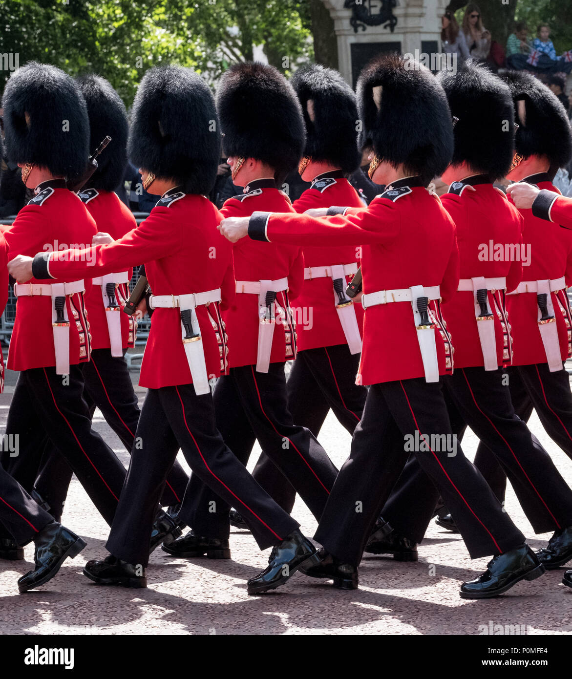 Guardsmen and women march down the The Mall, outside Buckingham Palace during Trooping the Colour military parade marking Queen Elizabeth's birthday. - Stock Image