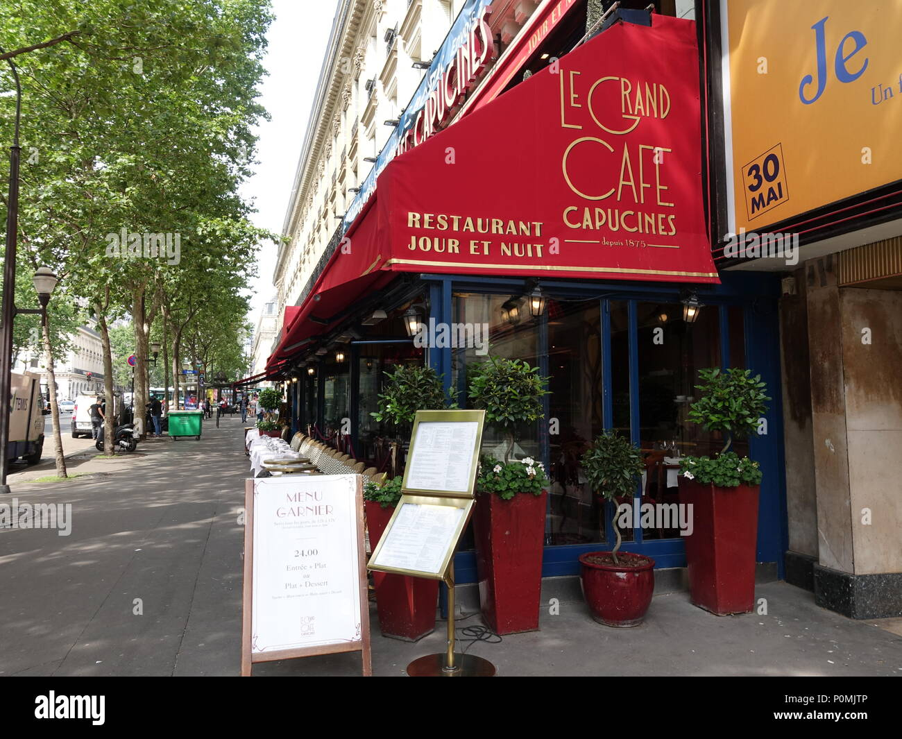 Cafe ready for service, before the lunchtime hour, terrace of Le Grand Cafe Capucines, Paris, France - Stock Image