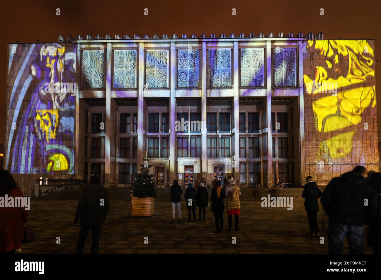 Cracow, Poland - February 3, 2018: Mapping on the facade of the National Museum inspired by the painting of Stanislaw Wyspianski. Krakow, Poland - Stock Image