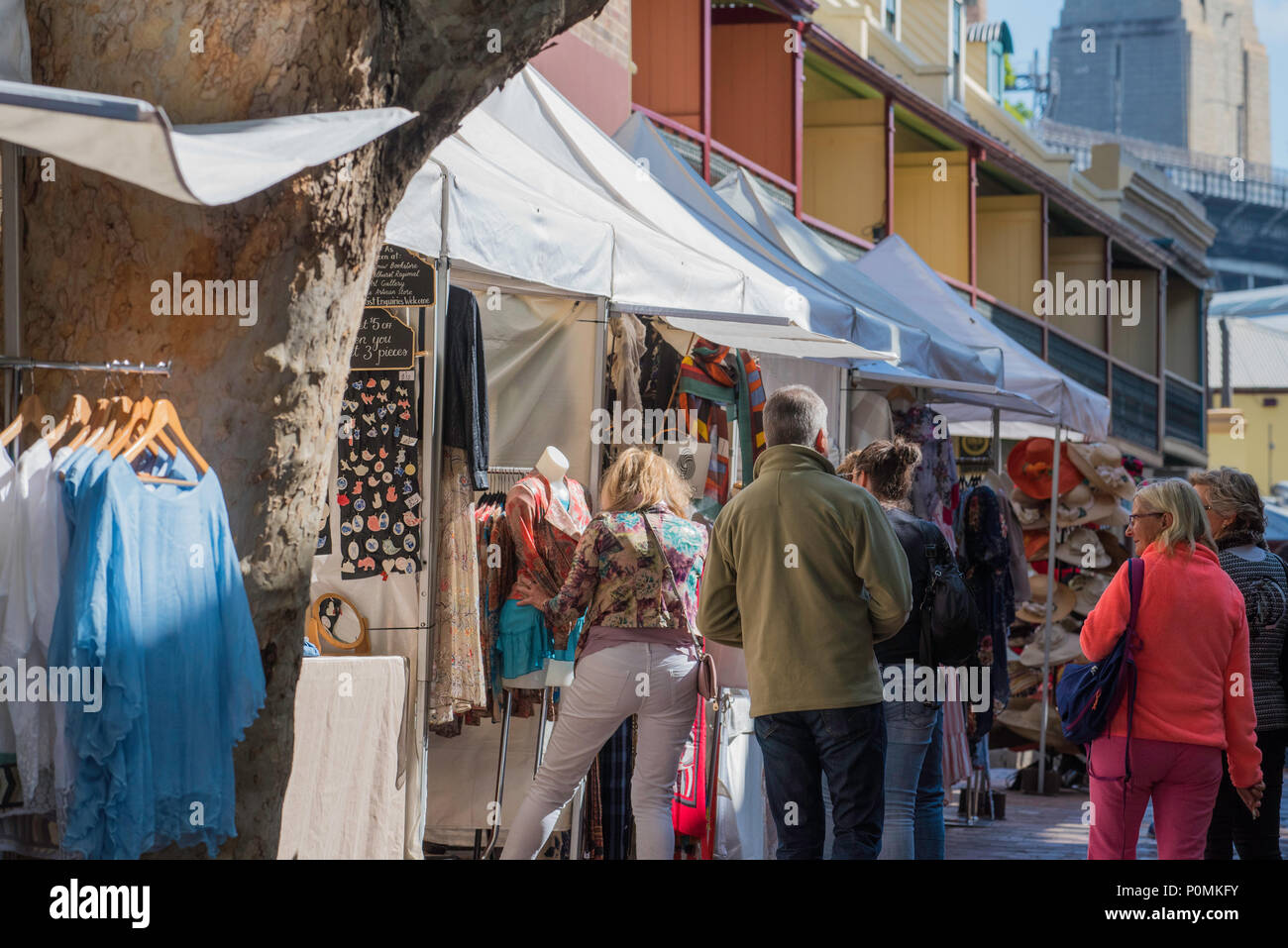 Market stalls selling fashion and art, part of a large weekend market in Sydney's historic Rocks Precinct in New South Wales, Australia - Stock Image